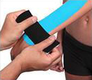 Kinesio tape precut wrist tape application step 3