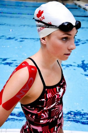 Canadian swimmer, Julia Wilkinson, wearing KT Tape Pro Canada edition